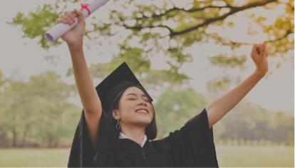 A graduate in a cap and grown